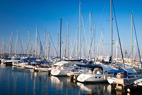 Boats are lined up at a marina